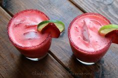 Garnish the strawberry margaritas with lime and strawberry slices