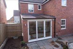 An Ultraframe Solid Conservatory Ultraroof Tiled Conservatory Roof, Modern Conservatory, Conservatories Uk, Roof Quotes, Warm Roof, Garage Roof, House Extensions, Home Improvement Projects, New Homes