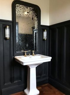 Monday Inspiration: Beautiful Rooms - Mad About The House - Love this aged antique mirror above the sink in the cloakroom with black wall panelling and parquet wooden flooring. Wc Retro, Mad About The House, Bathroom Wall Lights, Bathroom Lighting, Wall Lighting, Downstairs Toilet, Bathroom Inspiration, Monday Inspiration, Black Walls