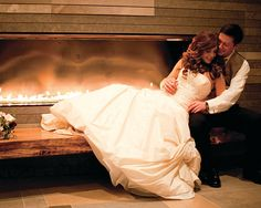 Picture perfect areas at your ceremony or  reception site. This newly-wed couple cuddle by the lobby fireplace at Four Seasons Hotel Seattle.