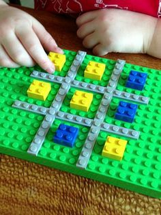 Use Legos to make your own colorful tic tac toe board!