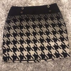 Mini black and white skirt Its a thicker skirt nice for the winter. Has adorable 4 buttons on the top worn only once! The Limited Skirts Mini