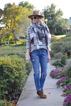 Striped top, plaid blanket scarf, tan hat, distressed jeans, chloe dupe bag, fringe boots by @straightastyle