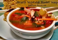 This hearty tomato-based veggie and barley soup features potatoes, celery, onions, carrots, and spinach for a power-punch of protein.