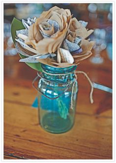 Inexpensive paper flower centerpiece. If you didn't have the budget for real flowers paper ones are better than fake plastic ones. You would come off as creative rather than cheap.