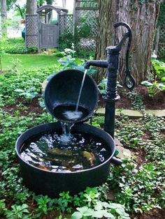 Creative Recycling    Rate My Space user On_the_east_twin made this charming, one-of-a-kind fountain using a cast-iron scalding pot, cauldron and hand pump. The falling water conceals the tube and wire for the submersible pump that's in the largest pot. Stones and ceramic koi add the perfect finishing touch.