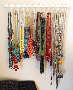 Sometimes jewelry boxes aren't the best way to store necklaces. Put them on display and prevent tangles with hooks.  Source: Instagram User abbeygrim