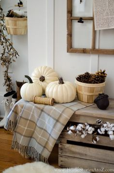 Neutral fall decorating has never been easier with these 7 Tips to Creating Simple Seasonal Vignettes. The white pumpkins, natural wood grains, and white walls set the tone in this lovely cottage chic home.
