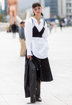 Street style image of black corset and white oversized shirt