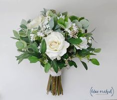 This wedding bouquet is made with high quality, silk flowers and eucalyptus. This neutral colored, silk bouquet incorporates ivory, white, and cream flowers and elements. The eucalyptus adds to the…More Eucalyptus Bouquet, Rustic Bouquet, Bride Bouquets, Hand Tied Bouquet, Bridesmaid Bouquets, Daisies Bouquet, Succulent Bouquet, Eucalyptus Wedding, Dream Wedding