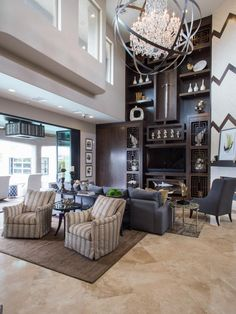 Drew and Jonathan Scott's great room includes a two story bookshelf with Asian design, as seen on HGTV's Property Brothers at Home.