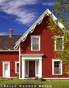 Red cottage. Adore the trim.
