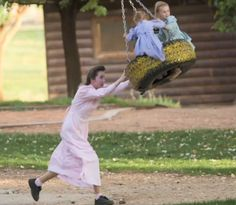 FLDS: mother pushes her children on a tire swing in the cult town of Colorado City.