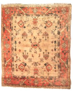 USHAK CARPET WEST ANATOLIA, CIRCA 1890 The pale camel field scattered with bold stylised palmettes, floral sprays, ewers, and minor motifs in a shaded apricot bold palmettes and angular hooked vine meander, between ivory hooked panel stripes, plain outer stripe, minimal wear 13ft.10in. x 11ft.9in. (418cm. x 358cm.)