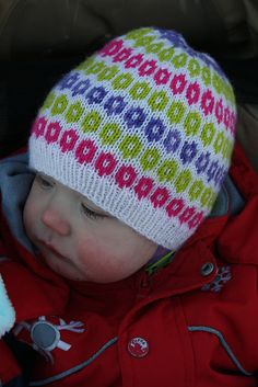 Knitted hat with daughter.