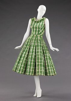 Rice Bowl Dress, Carolyn Schnurer, c. 1952    The neckline, inspired by a reversed kimono, emphasizes the wearer's collar bones and delicately frames the face. The geometric textile pattern is inspired by sekkazome paper (meaning snow flower or snowflake dyeing), a technique in which mulberry paper is accordion pleated, folded into various patterns and dip dyed. The skirt, which is vertically boned, was inspired by Japanese oilcloth parasols