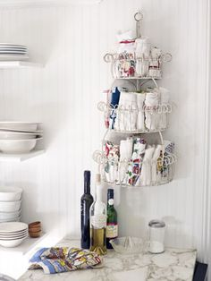 Cute way to store tea towels.