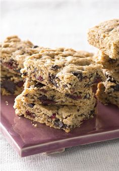 Chewy Chocolate Peanut Butter Bars -- Chocolate, peanut butter and oatmeal always make awesome cookie bars, but dried cranberries up the chewy goodness of these.