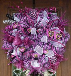This 26 Valentines Day wreath is beautiful with its hot pink and black color theme! It features candy sayings with a touch of leopard, hot pink glitter