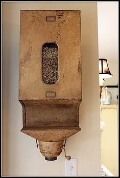 clever re-use of an old flour sifter bin to dispense dog food ~ really neat country decor idea ~