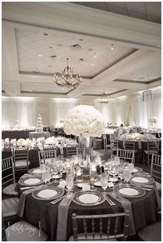 silver and white wedding reception, hurricane vase center pieces, custom linens, silver chiavari chairs, clear glass chargers- I think this is at Ballantyne resort Silver Wedding Decorations, Wedding Themes, Wedding Colors, Table Decorations, Wedding Flowers, Wedding Ideas, Grey Wedding Theme, Decor Wedding, Wedding Favours