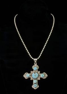 "Silver Turquoise Cross Necklace  Sterling silver cross with vintage look studded with turquoise stones. Cross is 3""""L x 2-1/2""""W including bail and hangs from an Italian sterling silver bead chain with lobster claw clasp.   http://www.sterlingjewelrystores.com/product562.html"