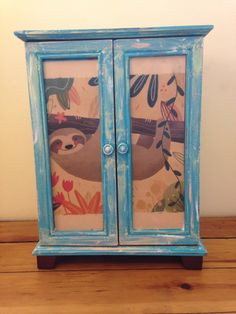 **ATTENTION: LIKE MY SHOP DURING THE MONTH OF FEBRUARY AND BE ENTERED IN A DRAWING TO WIN A FRAMED PICTURE OF CARTOON AMERICAN GIRL DOLLS AND A SCHOOL BAG WITH ACCESSORIES FOR DOLLS TOO!!!! SHIPPED FREE!  Rita Pita Boutique Presents:  A beautifully distressed and weathered doll dresser/hutch or closet done in a teal, yellow, white with 5 functional drawers and a spinning hanger for clothes or accessories! A perfect piece for a girl and her doll. Inspired by the girl of the year - Lea Cl...