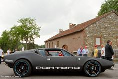 De Tomaso Pantera I remember trying to get into one of these... shoe horn and a jar of Vaseline and they still had to remove the steering wheel. Beautiful car however... a classic