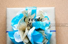 Tissue flower Pom-Pom gift wrapping - love the natural look of the Pom-Pom.  DIY