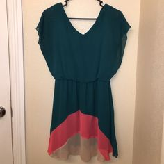 Tri colored flowy dress. Tri colored flowy dress. Back and front both have v neck. Very comfortable. Sweet Storm Dresses Mini