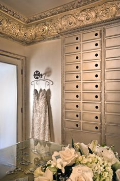 Elegant master closet is a hand-painted creation of A. Allbright Painting. They used eight different Modern Masters metallic paint colors, softly layered, rubbed and wiped back. The metallic colors range from white gold, lilac gold, to bronze and pearl essence. The beautifully crafted moldings and opulent walls replicate the old world luxury of 17th century Europe.