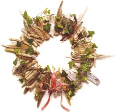 The wreath is constructed with many variations of driftwood twigs and shards. Remember a wreath is not just for Christmas and can be decorated in many ways to follow the seasons. I have also made mirrors in a similar fashion. The wreath featured p...