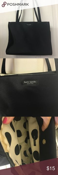 Black tote Inside has a one staining, outer shell in great condition kate spade Bags Totes