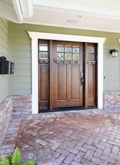 Brick entry and door. Loove this door and the contrasting color of the house