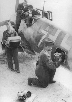 Ground crew prepares a German fighter for photographic services ( Fw 190 or Bf 109 ? )