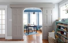 Sliding barn door from stock doors and track.  Make a more formal look by adding a wooden valence to hide the track.  Photo curtesy: Houzz