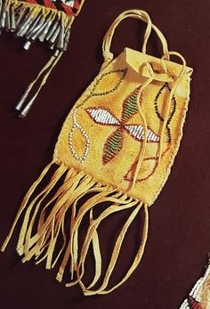 The pouch the Apache gives to Esperanza's son. Straw Bag, Bucket Bag, Two By Two, Pouch, Clay, Bags, Clays, Handbags, Sachets