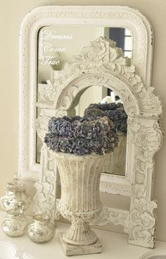 Such a pretty vignette with vintage frame and mirror. Think about something like this at the entry way of your event or as a small display on a dessert table. So many places you could use this type of application in.