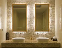 Stone vanity with #backlit mirrors #bathroom design