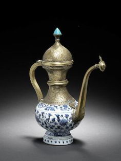 A Ming porcelain Ewer with Safavid brass mounts Persia and China, 16th and 17th Century