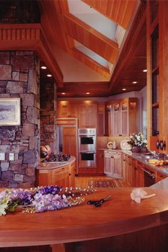 Kitchen with wood and stone and skylights like I want, not quite how I would have it but same ideas