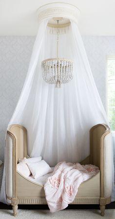 canopy bed & chandelier // little girls' pink & white bedroom