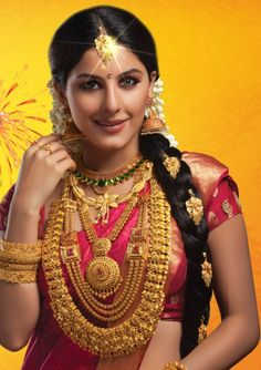 traditional south indian bride in heavy gold n red silk saree