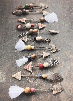 Use feathers, twine and twigs to make rustic arrow ornaments.