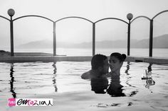 Engagement shooting in the Grande Albergo swimming pool with a stunning panorama on Portofino