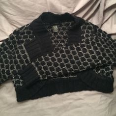 Crop Sparkle sweater Black and silver sparkle sweater. Long sleeves. Crop. Worn once or twice. Size M. Sweaters Shrugs & Ponchos