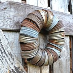 Repurpose jar lids to wreath by Funky Junk Interiors, featured at @totgreencrafts  These could also be painted to make them look shabby chic! Then tie on a burlap bow!