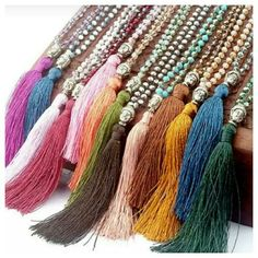 Buddha Beaded Tassel Necklace The orange and blue (blue one next to the orange one) are sold.  All other colors shown are available.  When you want to buy, let me know the color. Buddha Jewelry Necklaces