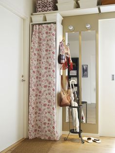 Get organized, show off your style and add a pop of color by hanging a curtain rod and fabric on a book case.