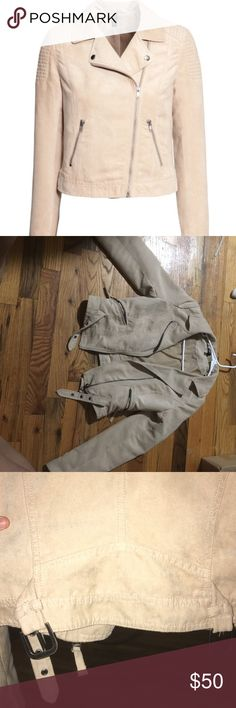 Suede biker jacket Worn once it's in great condition. It has buckles on the back as seen in photo and it has some in the front room. It has a square pattern feel on the shoulders. And it has zippers on the ending of the sleeves Divided Jackets & Coats